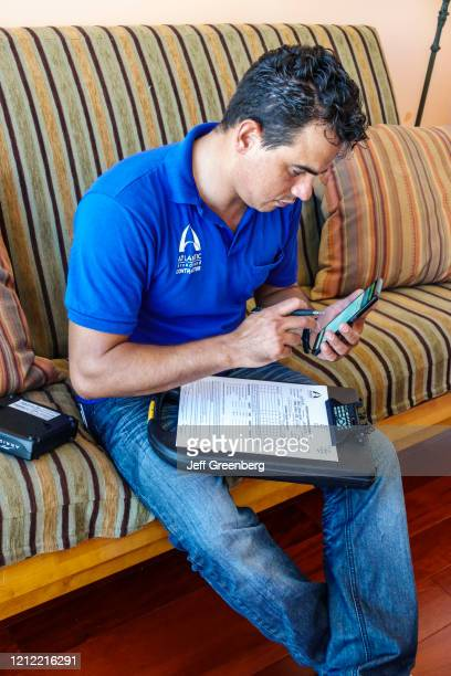 Miami Beach, Cable installation worker with smart tablet.