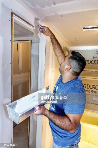 Miami Beach contractor installing drywall