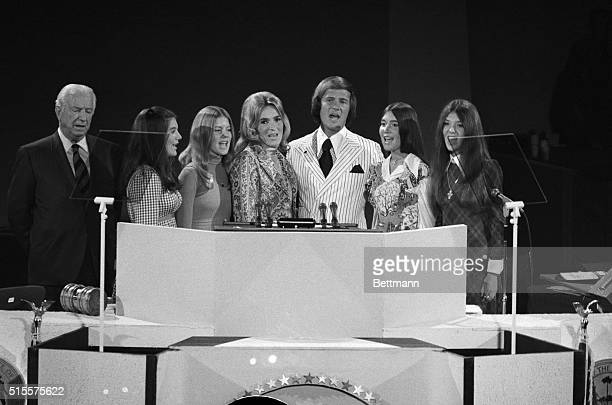 Miami Beach, FL: Singer Pat Boone and his family lead the GOP National Convention in the National Anthem at the beginning of the third session. From...