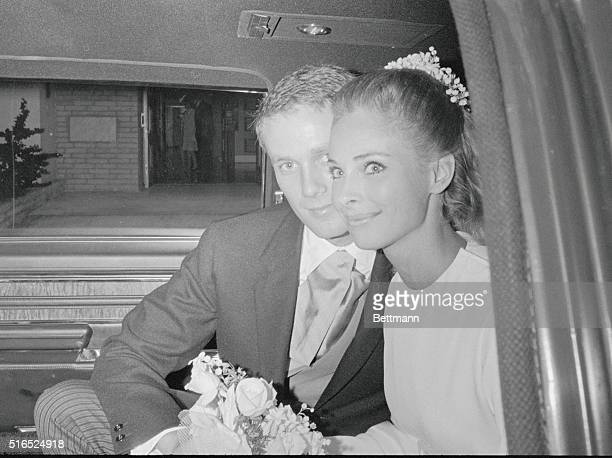 Herbert W Bunker Hoover III kisses his new bride Camilla Sparv Hoover in their car following their wedding at Miami Beach Hoover is the heir to the...