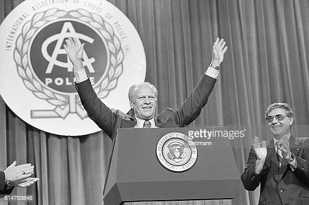 Miami Beach, FLA: President Ford smiles as he acknowledges the reception given to him at the convention of the International Association of Chiefs of...