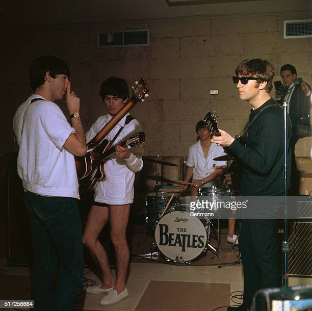 The Beatles in their bathing suits rehearse in the Deauville Hotel for their next appearance in the Sullivan TV show