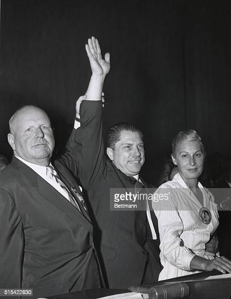 The Winner Outgoing teamster head Dave Beck lifts up the hand of his newlyelected successor James Hoffa as Hoffa's wife looks on happily Hoffa swept...