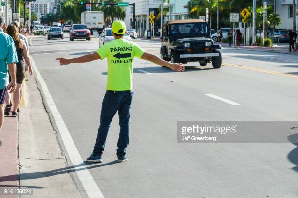 Miami Beach Parking Lot Attendant Guiding Customers