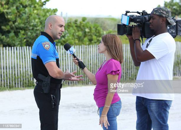 Miami Beach Police Officer Ernesto Rodriguez conducts an interview with an NBC 6 News reporter about the police response to the crime emergency...