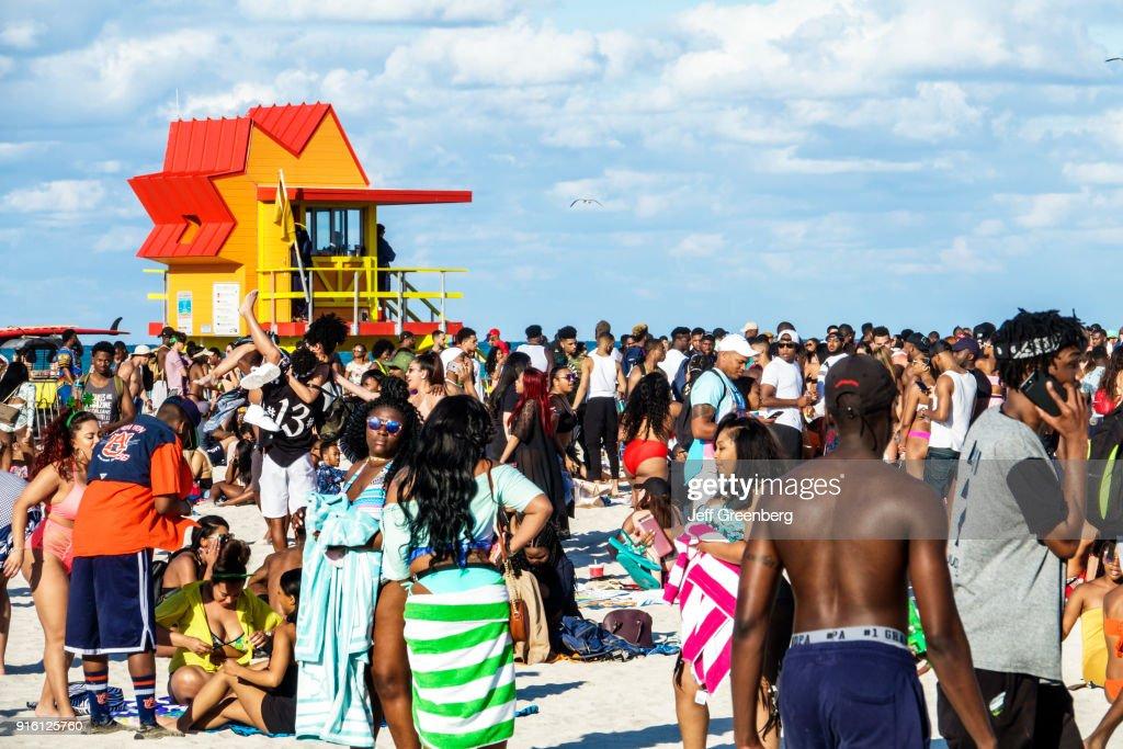 Miami Beach, Spring Break, lifeguard tower with crowds on beach : News Photo