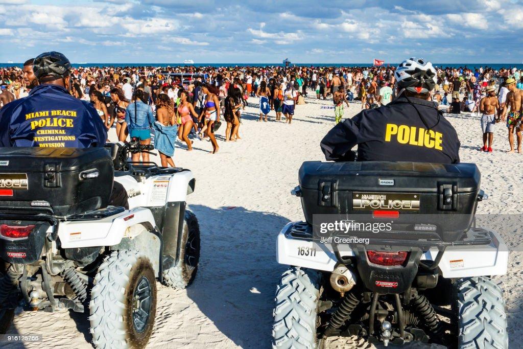 Miami Beach, Spring Break, Police on ATV's watching Beach Crowds : News Photo