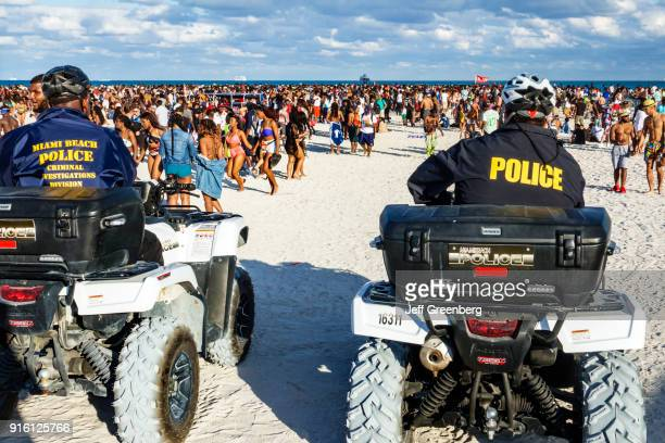 Miami Beach Spring Break Police on ATV's watching Beach Crowds