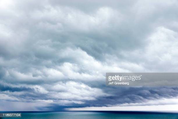 Miami Beach, Storm clouds over water.