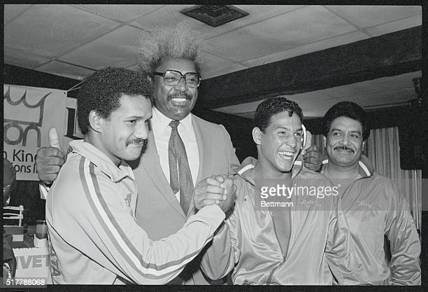 Boxing promoter Don King center poses September 22 with what would be a popular match up former WBC lightweight champ Edwin Rosario at a press lunch...