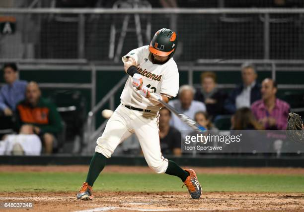 Miami catcher Joe Gomez at bat during a college baseball game between the Dartmouth College Big Green and the University of Miami Hurricanes on March...