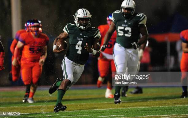 Miami Central running back James Cook scores a touchdown against Bishop Gorman in the second quarter of a prep football game between the Miami...