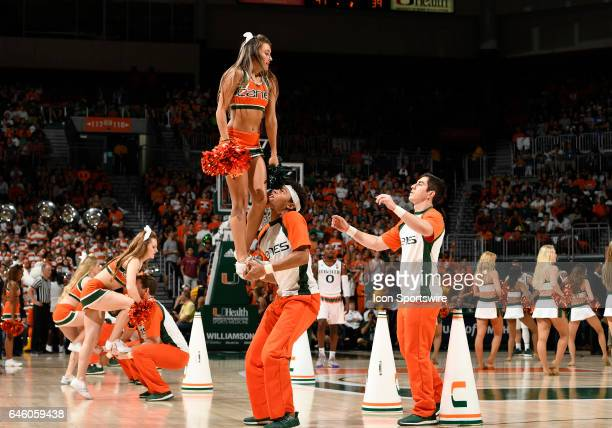 Miami cheerleaders perform during a college basketball game between the Duke University Blue Devils and the University of Miami Hurricanes on...