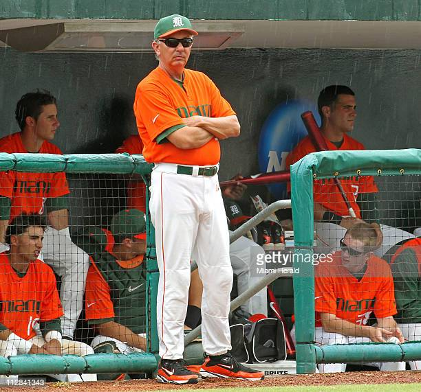 Miami coach Jim Morris watches the rain come down during action against Texas AM at Alex Rodriguez Park at Mark Light Field in the NCAA Coral Gables...