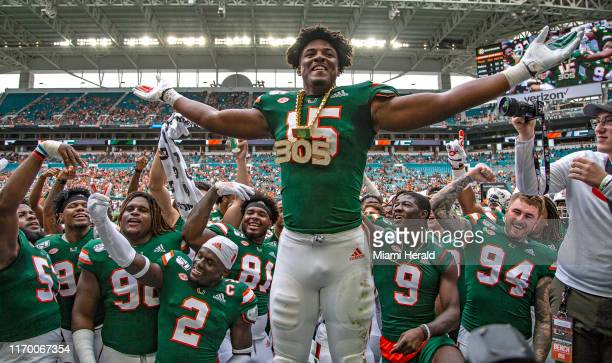 Miami defensive lineman Gregory Rousseau wears the turnover chain for the first time in his career when he recovered a fumble that he caused in the...