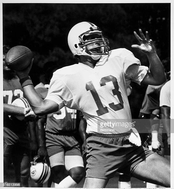 Miami Dolphin rookie quarterback Dan Marino who starred at the University of Pittsburgh winds up for a long pass during the Dolphin practice 8/4...