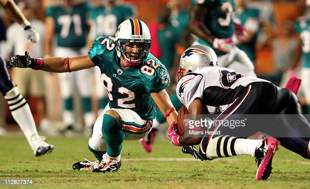 Miami Dolphins' Brian Hartline watches the New England Patriots' Jarrad Page intercept a pass late in the fourth quarter at Sun Life Stadium in Miami...