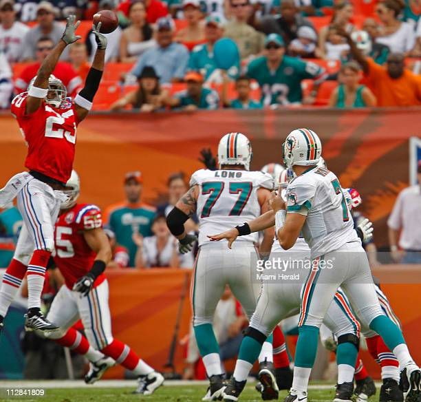 Miami Dolphins' Chad Henne throws a pass that is knocked down by New England Patriots safety Pat Chung in the third quarter The Dolphins defeated the...