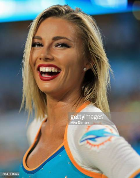 Miami Dolphins cheerleader looks on during a preseason game at Hard Rock Stadium on August 17 2017 in Miami Gardens Florida