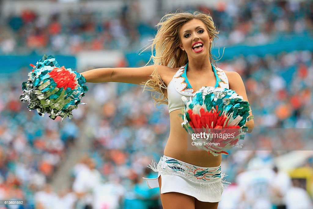 A Miami Dolphins cheerleader performs during a game against the Tennessee Titans at Hard Rock Stadium on October 9, 2016 in Miami Gardens, Florida.