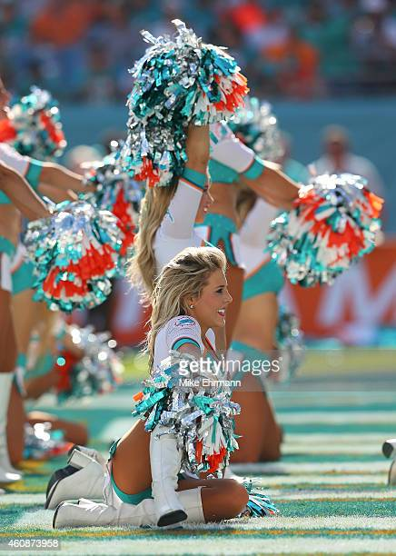 Miami Dolphins cheerleaders perform during a game against the New York Jets at Sun Life Stadium on December 28 2014 in Miami Gardens Florida
