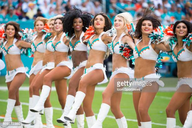 Miami Dolphins cheerleaders perform during an NFL game between the Tennessee Titans and the Miami Dolphins on October 8 2017 at the Hard Rock Stadium...