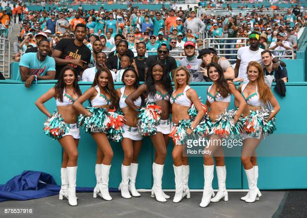 Miami Dolphins cheerleaders pose with members of the Miami Heat team during the game against the New York Jets at Hard Rock Stadium on October 22...