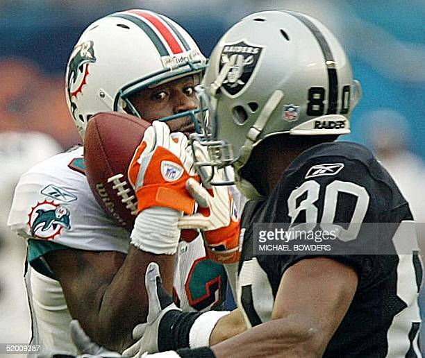Miami Dolphins' cornerback Patrick Surtain intercepts a Rich Gannon pass intended for Oakland Raiders' wide receiver Jerry Rice late in the 4th...