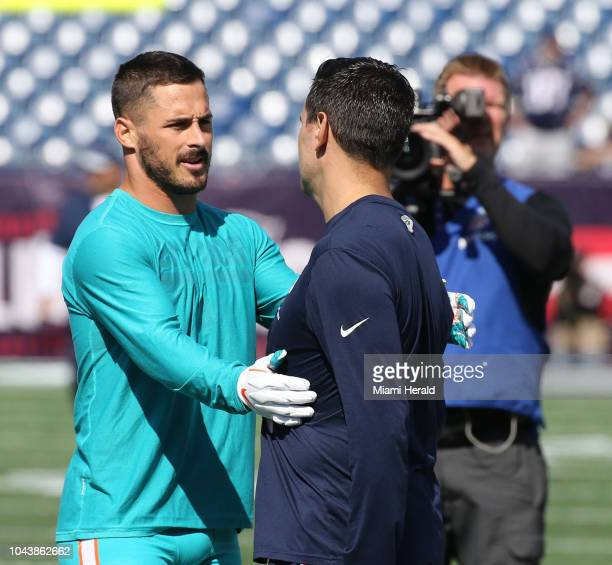 Miami Dolphins' Danny Amendola greets a former teammate before the game with the New England Patriots on Sunday Sept 30 2018 at Gillette Stadium in...