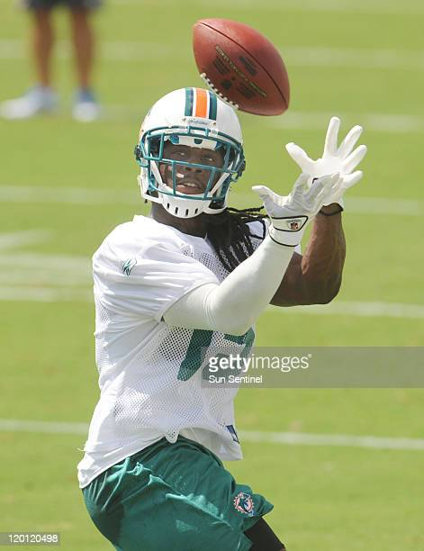 Miami Dolphins' Dayone Bess makes a catch during a training camp workout on Saturday, July 30 at the team's training facility in Davie, Florida.