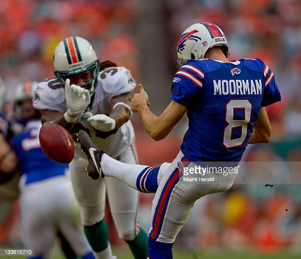 Miami Dolphins defensive back Chris Clemons blocks the punt of Buffalo Bills' Brian Moorman in the third quarter Miami defeated Buffalo 358 at Sun...