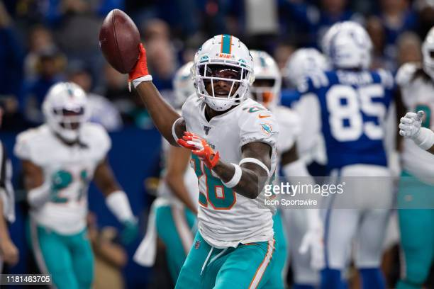 Miami Dolphins defensive back Steven Parker celebrates an interception in the endzone during the NFL game between the Miami Dolphins and the...