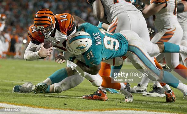 Miami Dolphins defensive end Cameron Wake sacks Cincinnati Bengals quarterback Andy Dalton for a gamewinning safety in overtime at Sun Life Stadium...