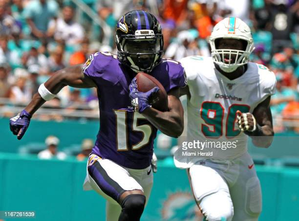 Miami Dolphins defensive end Charles Harris chases Baltimore Ravens Marquise Brown as he runs for a first quarter touchdown on Sunday, Sept. 8, 2019...