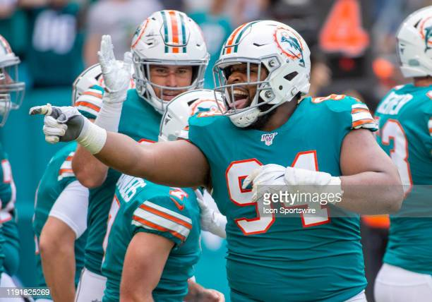 Miami Dolphins Defensive End Christian Wilkins laughs and taunts the Eagles players after Miami Dolphins Place Kicker Jason Sanders scored a...
