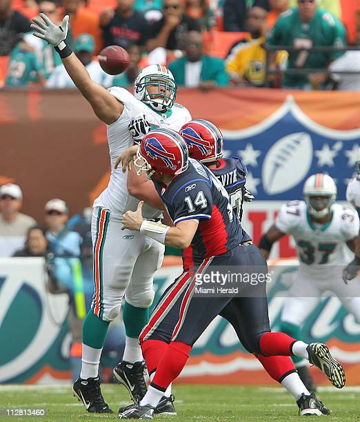 Miami Dolphins' defensive end Phillip Merlin can't knock down a pass by Buffalo Bills quarterback Ryan Fitzpatrick in the second quarter at Sun Life...