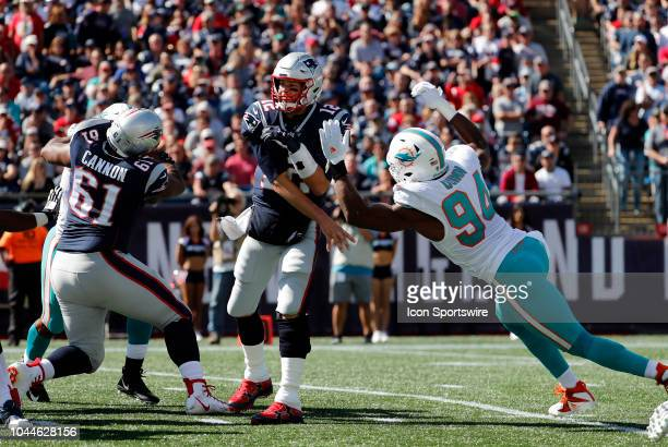 Miami Dolphins defensive end Robert Quinn arrives late on New England Patriots quarterback Tom Brady during a game between the New England Patriots...