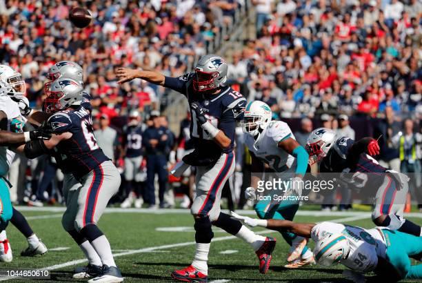Miami Dolphins defensive end Robert Quinn misses New England Patriots quarterback Tom Brady during a game between the New England Patriots and the...