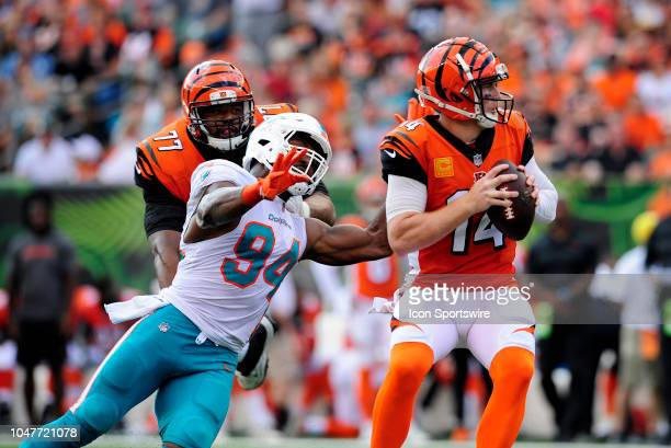 Miami Dolphins Defensive End Robert Quinn reaches out for Cincinnati Bengals Quarterback Andy Dalton during an NFL game between the Miami Dolphins...