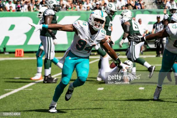 Miami Dolphins Defensive End Robert Quinn reacts to getting a quarterback sack during the second quarter of a National Football League game between...