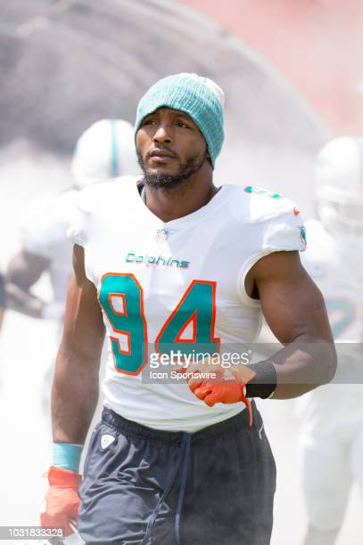 Miami Dolphins Defensive End Robert Quinn runs onto the field before the start of the NFL football game between the Tennessee Titans and the Miami...