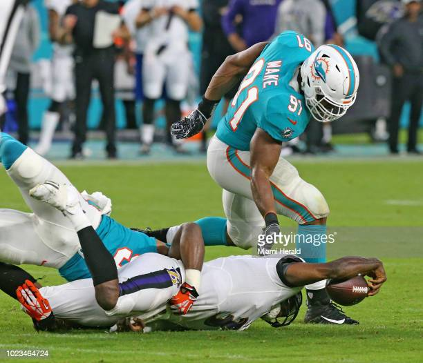 Miami Dolphins defensive ends Robert Quinn and Cameron Wake sack Baltimore Ravens quarterback Robert Griffin III in the second quarter on Saturday...