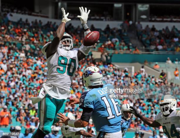 Miami Dolphins defensive lineman Charles Harris knocks down a pass by Tennessee Titans quarterback Matt Cassel in the second quarter at Hard Rock...