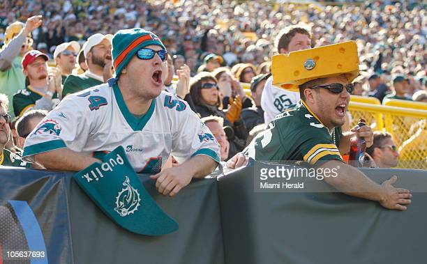 Miami Dolphins' fan and a Green Bay fan yell during the third of an NFL game at Lambeau Field in Green Bay, Wisconsin, Sunday, October 17, 2010. The...
