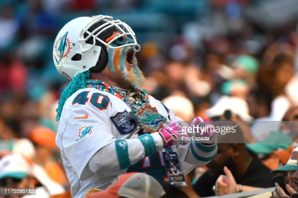 Miami Dolphins fan yells during the first half of the game against the Washington Redskins at Hard Rock Stadium on October 13, 2019 in Miami, Florida.