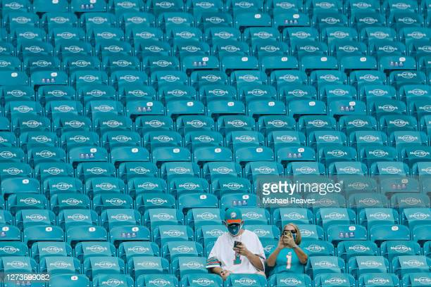 Miami Dolphins fans look on from the stands prior to the game between the Miami Dolphins and the Buffalo Bills at Hard Rock Stadium on September 20,...