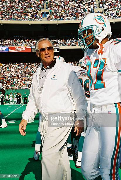 Miami Dolphins football coach Don Shula walks alongside some of his players during a game against the New York Jets Piscataway NJ September 1994