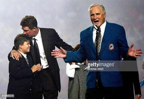 Miami Dolphins former head coach Don Shula speaks about former Dolphins quarterback Dan Marino as Marino kisses his son Joseph during a ceremony to...