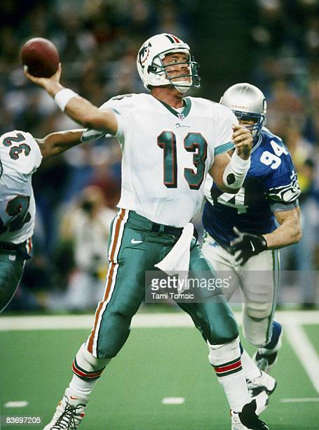Miami Dolphins Hall of Fame quarterback Dan Marino fires a pass during the AFC Wildcard Playoff, a 20-17 victory over the Seattle Seahawks on January...
