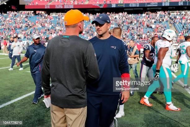 Miami Dolphins head coach Adam Gase and New England Patriots special teams coach Joe Judge after a game between the New England Patriots and the...